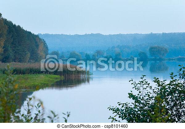 Autumn misty evening lake - csp8101460