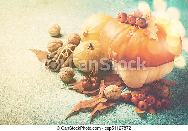 Autumn pumpkin Thanksgiving composition with leaves and nuts - csp51127872