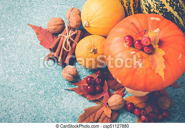 Autumn pumpkin Thanksgiving composition with leaves and nuts. Top view - csp51127880