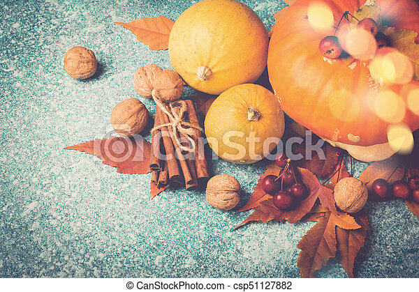 Autumn pumpkin Thanksgiving composition with leaves and nuts. Top view - csp51127882