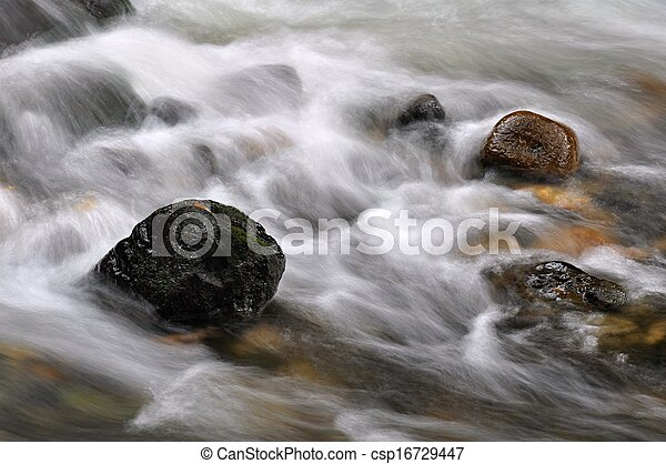 Autumn river with stones - csp16729447