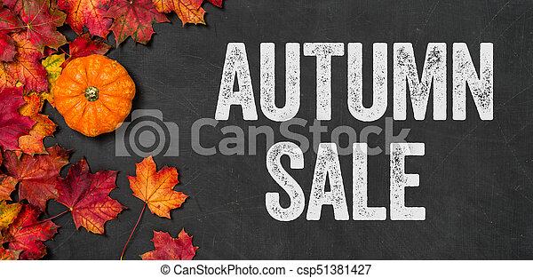 Autumn sale written on a blackboard - csp51381427