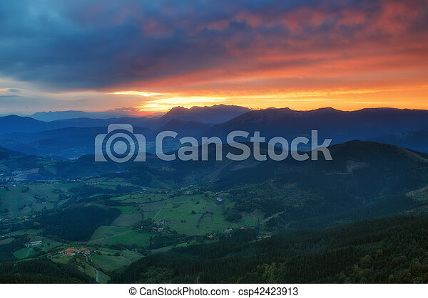 Autumn sunrise, typical autumn sunrise with south wind in the Basque Country - csp42423913