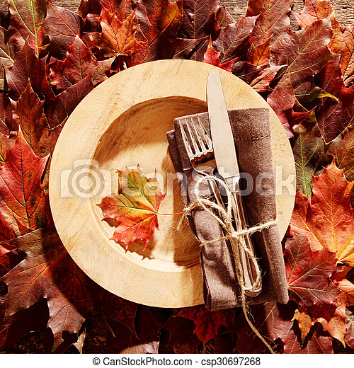 Autumn themed place setting - csp30697268
