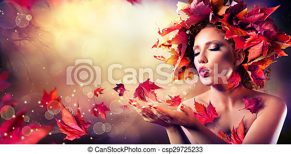 Autumn woman blowing red leaves  - csp29725233