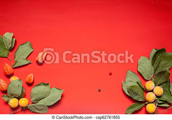 AUTUMN YELLOW LEAVES ON A RED BACKGROUND - csp62761855
