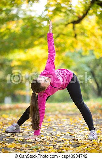 Autumn Yoga: Trikonasana pose - csp40904742