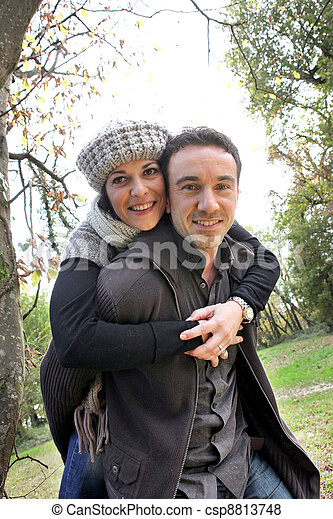 Autumnal couple in the woods - csp8813748
