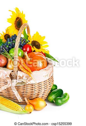 autumnal harvest vegetables and fruits in basket - csp15255399