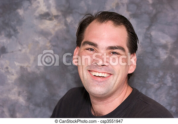 Average Man Laughing A Good Looking Regular Guy Is Looking Directly