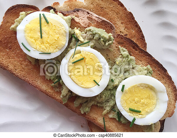 Avocado toast with boiled egg slices - csp40885621