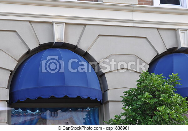 Awning On Building With Tree In Front
