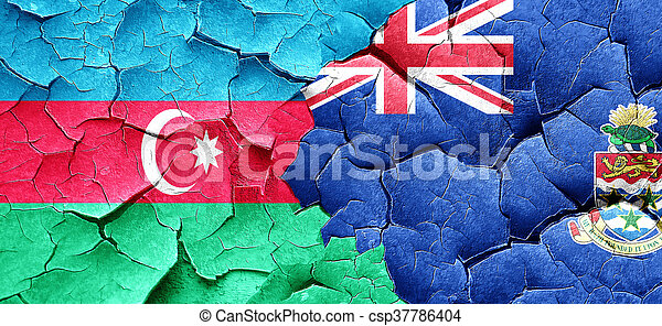 Azerbaijan flag with Cayman islands flag on a grunge cracked wal - csp37786404