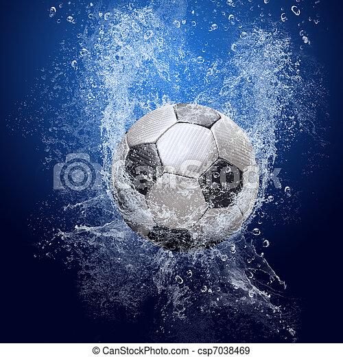 El agua cae alrededor de la pelota de fútbol en el fondo azul - csp7038469