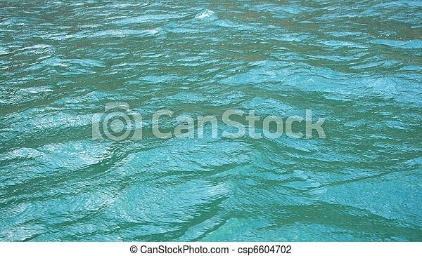 Azure sea water surface with ripple as background  - csp6604702