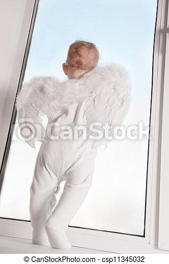 Baby angel in window - csp11345032