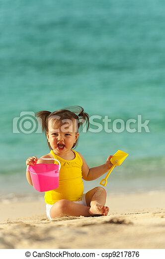 Baby at the beach - csp9217876