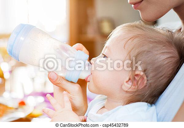 Baby boy food mother - csp45432789