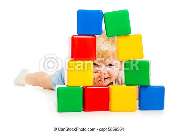 baby boy hidden behind building blocks - csp15859364
