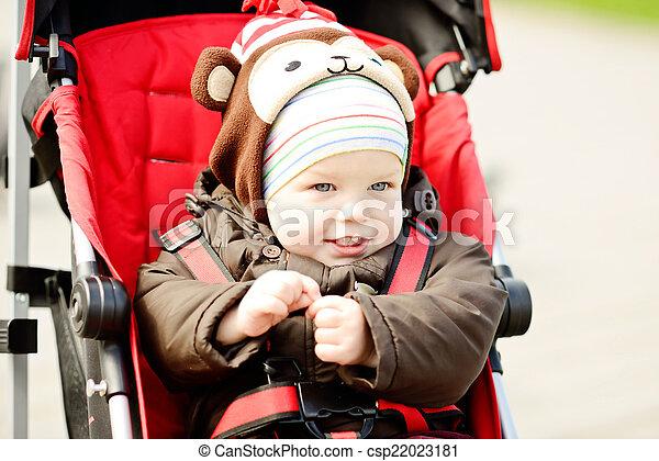 baby boy in red stroller - csp22023181