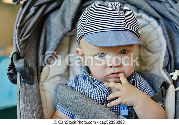 baby boy in stroller - csp52338893