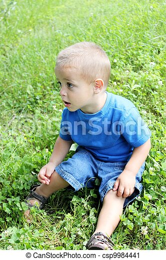Baby boy playing outside - csp9984441
