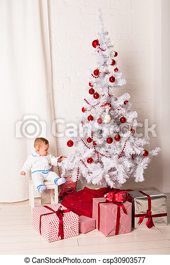 baby boy playing with Christmas tree decoration - csp30903577