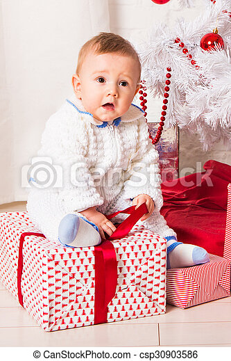 baby boy playing with Christmas tree decoration - csp30903586