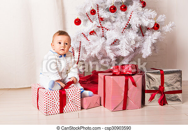 baby boy playing with Christmas tree decoration - csp30903590