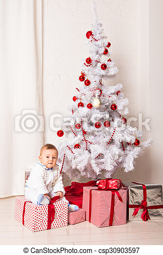 baby boy playing with Christmas tree decoration - csp30903597