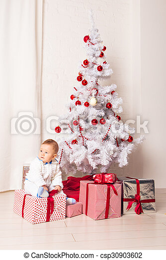 baby boy playing with Christmas tree decoration - csp30903602
