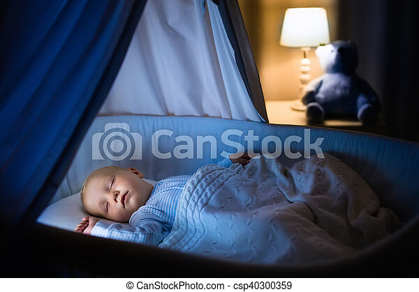Baby boy sleeping at night - csp40300359