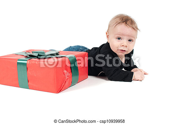 Baby boy with christmas present - csp10939958