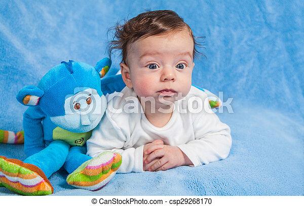 Baby boy with monkey - csp29268170