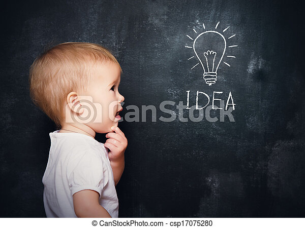 baby child at the blackboard with chalk drawn bulb symbol ideas - csp17075280