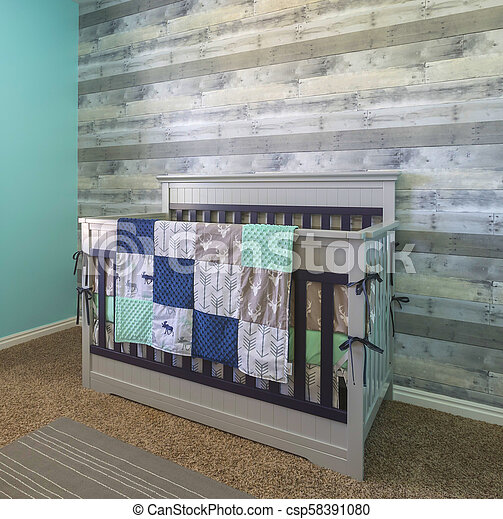 Baby crib for new born in a modern bedroom - csp58391080