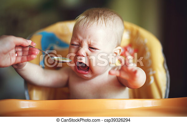 baby cry, capricious, refuse to eat - csp39326294