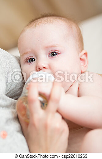 baby drinking water from bottle - csp22610263