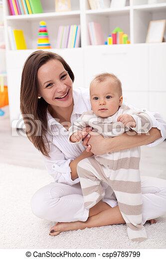 Baby girl anxiously wants to walk - csp9789799