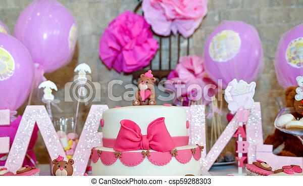 baby girl first birthday cake with teddy bear