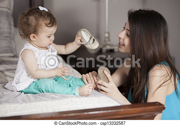 Baby girl getting dressed - csp13332587