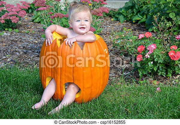 baby girl in pumpkin - csp16152855