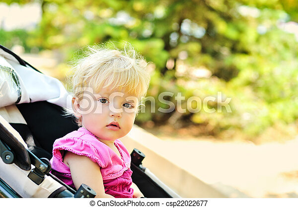 baby girl  in stroller - csp22022677