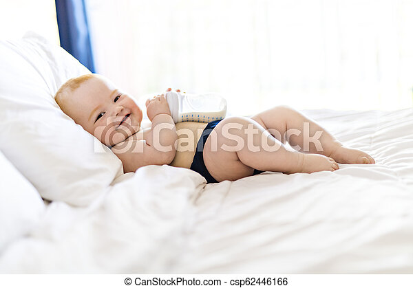 baby girl in the bed at home - csp62446166