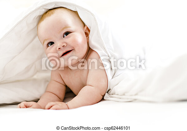 baby girl in the bed at home - csp62446101