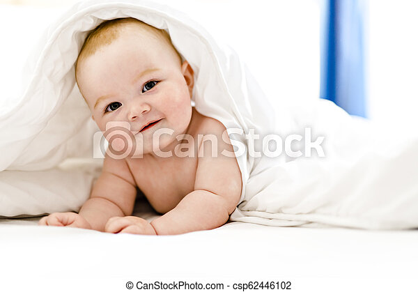 baby girl in the bed at home - csp62446102