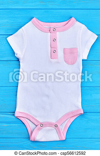 a787d9b1d98 Baby-girl organic cotton bodysuit. short sleeve high quality white romper  for infant girl on blue wooden background.