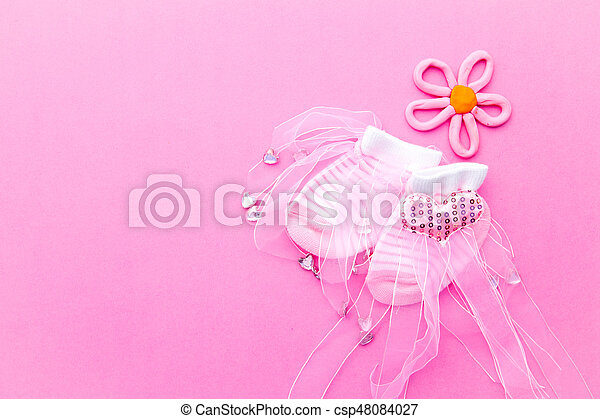 baby girl pink and white socks with flower on pink background