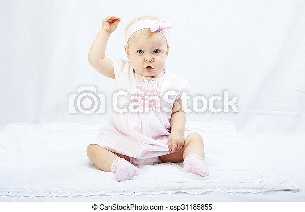 baby girl  playing in the white studio surroundings - csp31185855