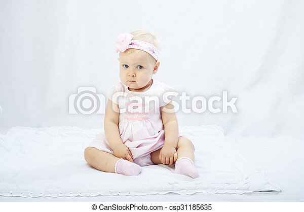 baby girl  playing in the white studio surroundings - csp31185635